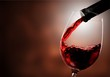 canvas print picture - Red wine pouring in glass on  background