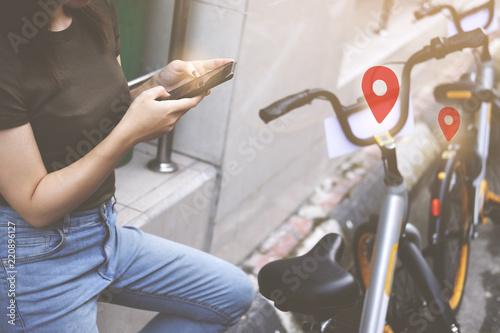 Canvas Prints Kuala Lumpur Female booking a public rental bicycle by application on smart phone.