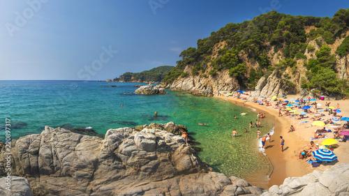 Fotografie, Tablou Lloret de Mar, Costa Brava, Spain - august 24, 2018: Amazing view of Cala Sa Boadella platja beach in Lloret de Mar of Costa Brava at Catalonia Spain on sunny clear summer day