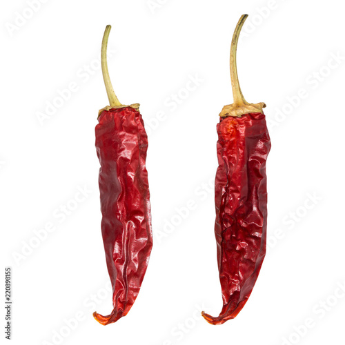 Staande foto Hot chili peppers Dry chili pepper isolated on white. Dried vegetable