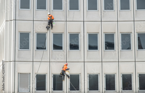 Two man rappelling from the wall for fix the damaged building in Christchurch, New Zealand Wallpaper Mural