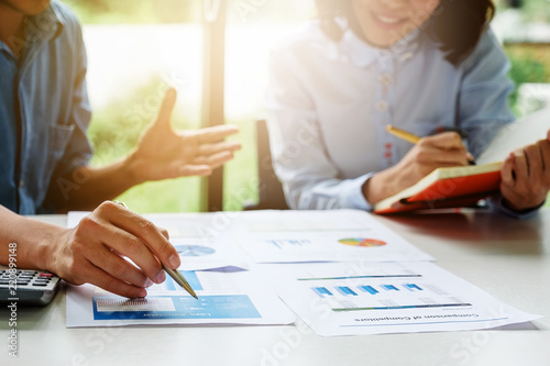 Tableau sur Toile Businessman and partner hand holding pencil and making presentation business strategy
