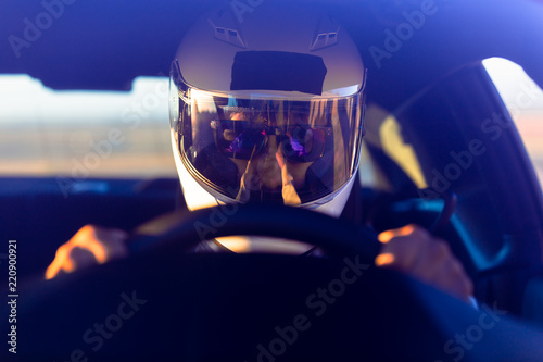 Photo sur Toile F1 A Helmeted Driver At The Wheel Of His Race Car