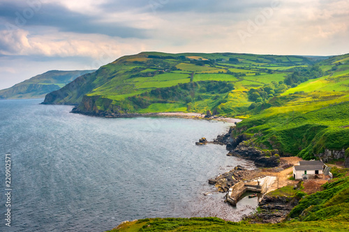 Fotografia  Scenic landscape of green coastline at Torr Head, Antrim, Northern Ireland