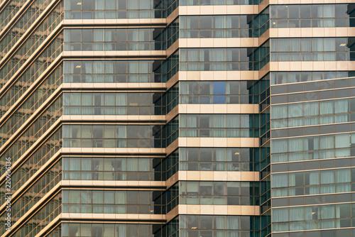 Deurstickers Stad gebouw Facade of a multi-storey building, close-up