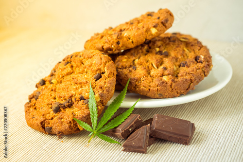 Fotografie, Obraz  Delicious homemade Chocolate chip Cookies with CBD cannabis and