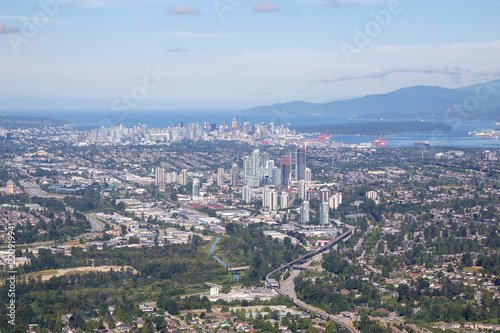Aerial view of Brentwood Centre with Downtown City in the Background.
