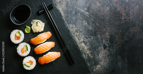 Tuinposter Sushi bar Sushi served on plate on dark table