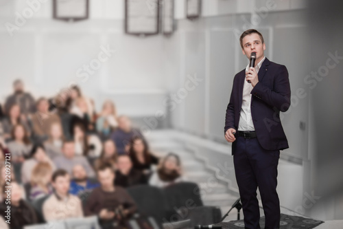 speaker conducts the business conference for journalists and aspiring entreprene Canvas Print
