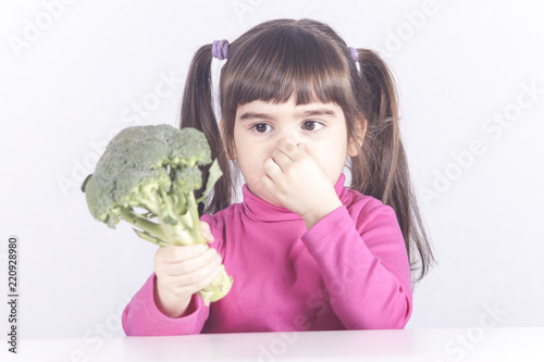 Little girl refuses to eat her broccoli