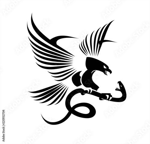 Fototapeta premium Orzeł i żmija, orzeł kontra wąż, drapieżnik i zdobycz;