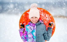 Funny Girl With Saucer Sled Ou...