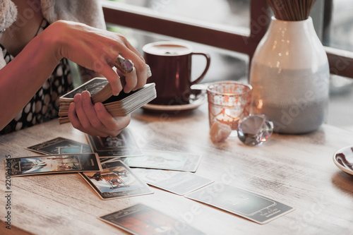 Woman is reading Tarot cards in cafe Canvas Print