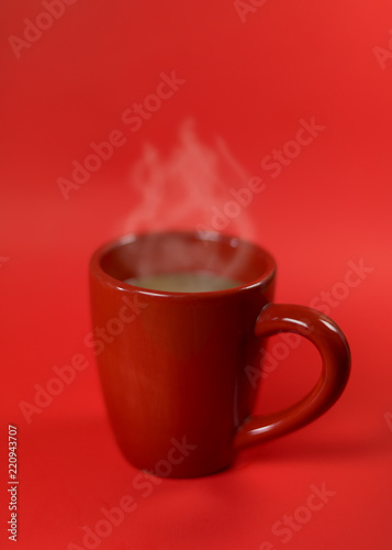 Fotografie, Obraz  a red cup of coffee on the red background with space for product display montage