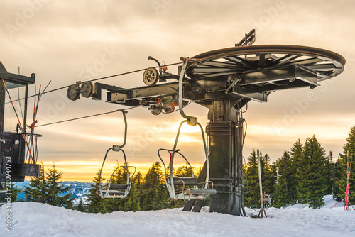ski lift with seats going over the snow mountain in ski resort.