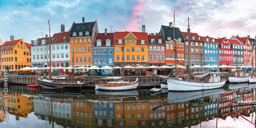 Poster Europese Plekken Nyhavn at sunrise, with colorful facades of old houses and old ships in the Old Town of Copenhagen, capital of Denmark.