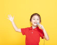 Happy Little Girl Singing On Y...