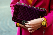 Fashion Details: Velvet Violet Quilted Bag In Hands Of Elegant Woman. Lady Wearing Wrist Watch. Copy, Empty Space For Text