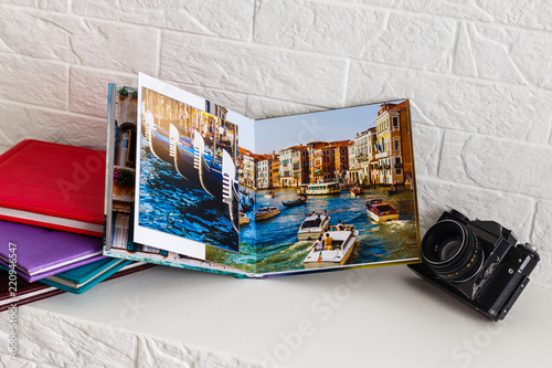 Obraz view open book with album at home - fototapety do salonu
