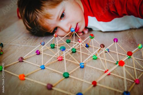 Fotografie, Obraz  child making geometric shapes, engineering and STEM