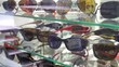 Sunglasses layout on shalves in a store front showcase of a shop