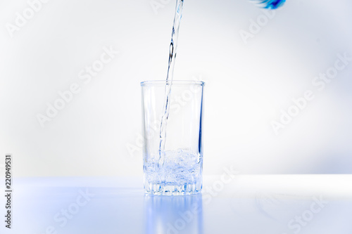 Papiers peints Eau Glass of pure water on a white kitchen table