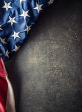 American Flag On Dark Concrete With Free Space.