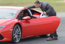 Man Testing A Red Fast Car