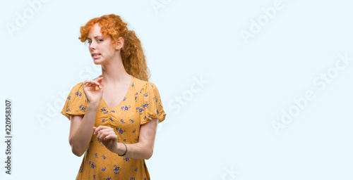 Fotografie, Tablou  Young redhead woman disgusted expression, displeased and fearful doing disgust face because aversion reaction