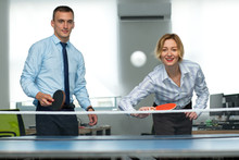 Business Man And Woman Are Playing Together In Table Tennis. Play In The Team. Office Games During A Working Break.