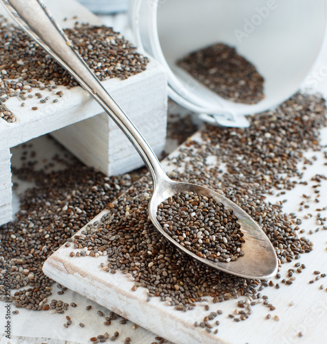 Deurstickers Kruiderij Chia seeds with a wooden spoon