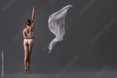 Fotografie, Obraz  Sexy girl in beige underwear in rearview