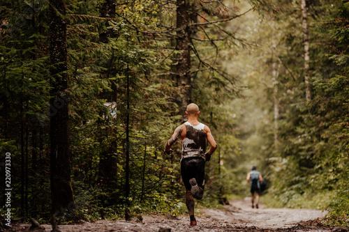 Obraz na plátně muddy runner athlete running forest autumn trail