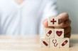 Leinwanddruck Bild - Hand arranging wood block stacking with icon healthcare medical, Insurance for your health concept