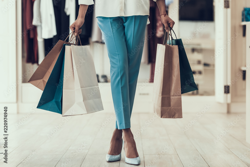 Fototapety, obrazy: Closeup Young Girl holding Shopping Bags in Store