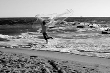 Surf Fisherman With Casting Net On The Beach Trying To Catch Bait Fish