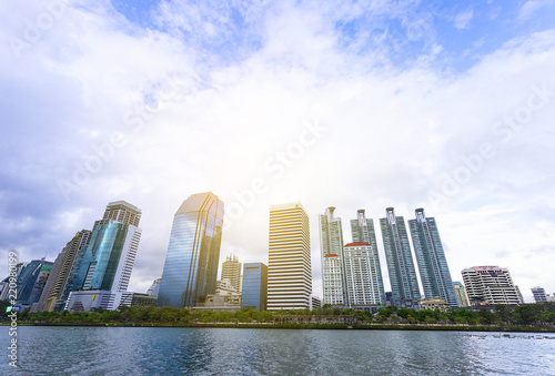 Bangkok, Thailand - August 18, 2018 : Lake Ratchada situated in the Benjakitti Park with modern buildings in the background in midtown Bangkok, Thailand Wallpaper Mural