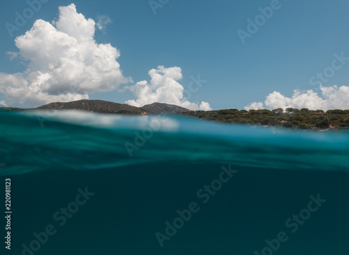 Poster Glaciers Half underwater view of beautiful place in - Sardinia - italy