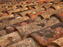 Pattern Of Old Red Tiles Closeup On Roof