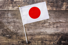 Japanese Flag On Wooden Background. Top View