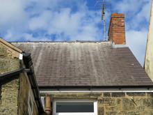 Shoddy Roofing Work By Cowboy Builder. Results Of Rouge Worker Posing As Skilled Tradesman. Badly Pointed Ridge Tiles On Slate Roof, Mortar Running Down Tiles.