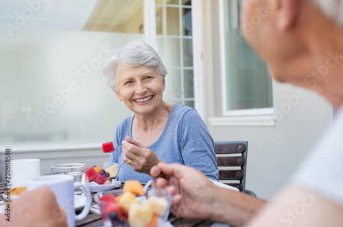 Senior couple having breakfast
