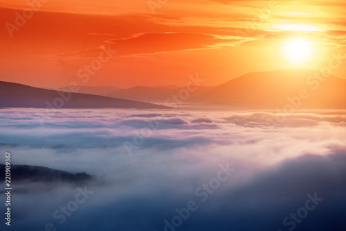 Colorful landscape in mountains with fog and sun