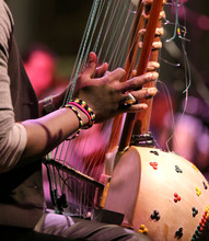 African Man Plays A Stringed Instrument At Live Concert