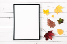 Autumn Composition. Colorful Leaves, Front View Of Empty Photo Frame On White Wooden Rustic Background. Autumn Concept. Flat Lay, Top View, Copy Space