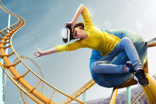 Poster Attraction parc Young woman used Virtual reality helmet VR. She see Roller-coaster park