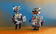 Robots Communication, Artificial Intelligence Concept. Two Robotic Characters With Light Bulb.