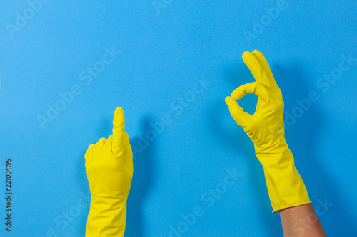 Woman hands with yellow rubber gloves making a gesture meaning ok and points upw Tapéta, Fotótapéta