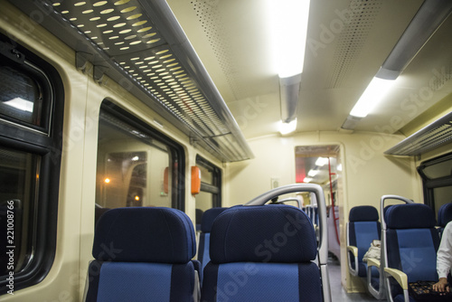 Poster Avion à Moteur Red blue comfortable seats on the train,
