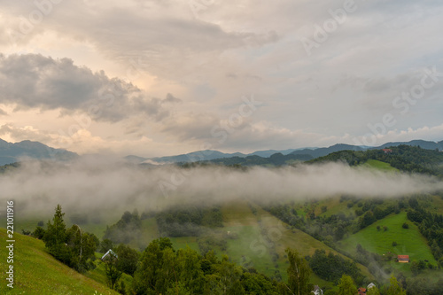 Spoed Foto op Canvas Bleke violet Stunning nature with misty landscape,Holbav village,Carpathians,Transylvania,Romania,Europe